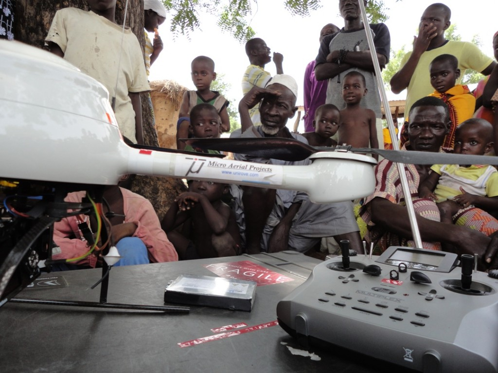 Micro Aerial Projects engaging the community, explaining the process of uav mapping in a village