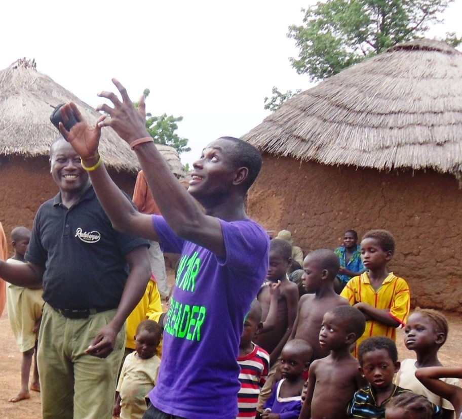 community excitement as they engage with Micro Aerial Projects on a mapping and land registration project for their village, africa