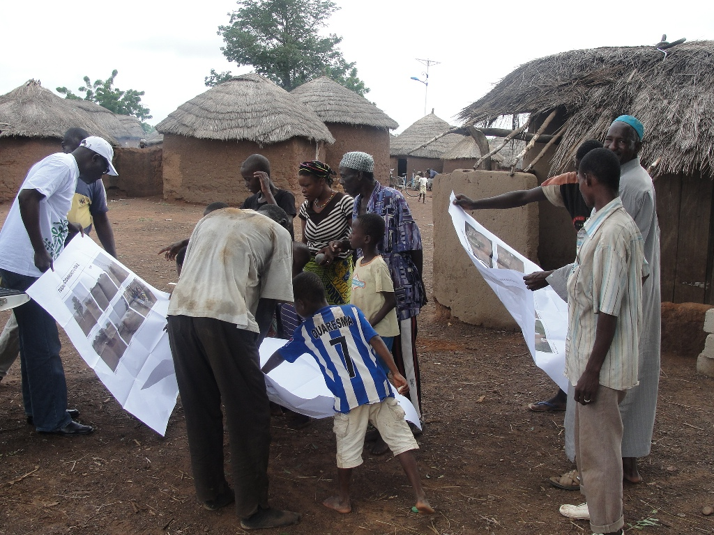 villagers seeing uav photos of their village