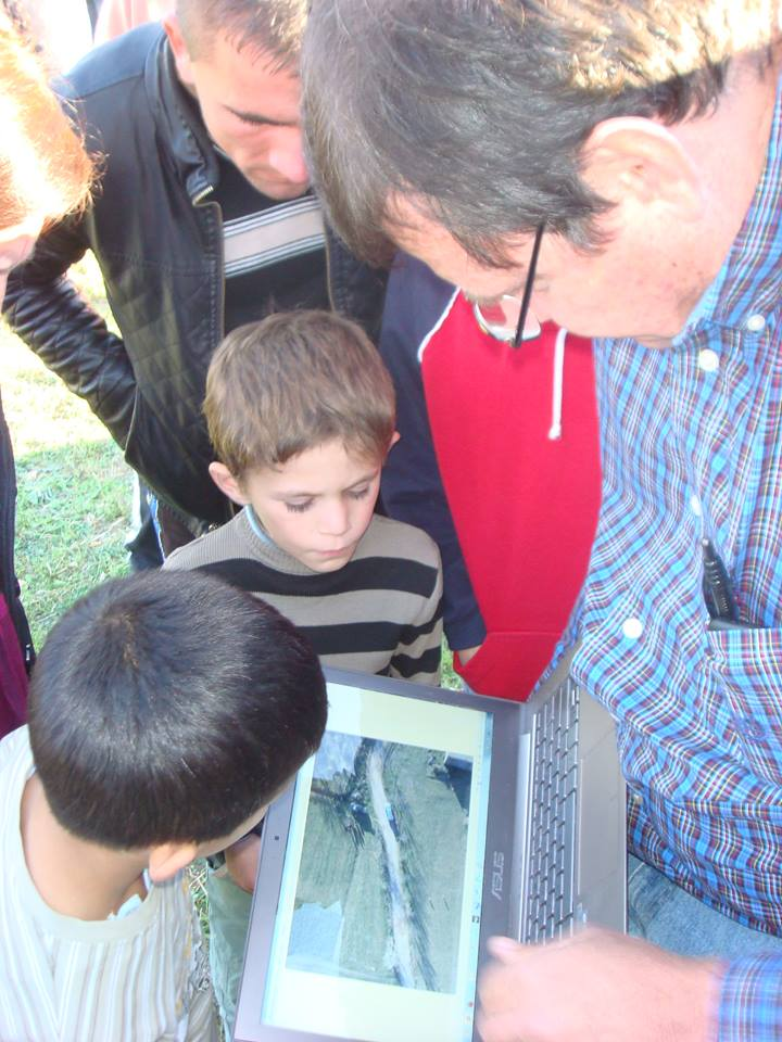 showing small UAV photography to the young