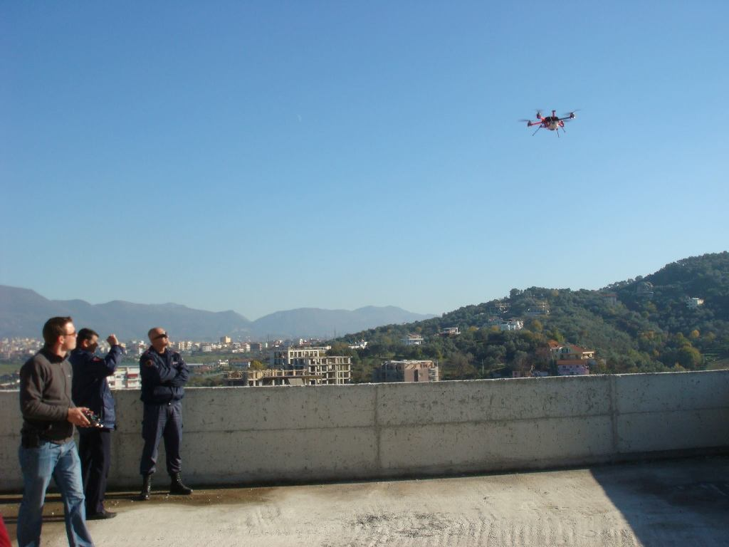 Oliver Volkmann of Micro Aerial Projects using a small uav with the v-map precise aerial mapping system on a World Bank land project in Albania